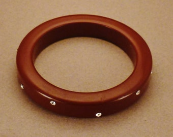 Moderne BAKELITE BRACELET CUFF rhinestones  Round red caramel Cuff in wide  3 1/2 in diam