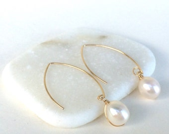 """Classic White Pearl Drop Earrings on Marquise earring wires. Elegant and easy to wear. Approximately 1.5 """" long, see listing for sterling"""