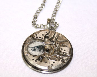 Hiding Places - upcycled metal and resin pendant with old watch parts