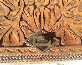 1950s hand tooled and cut-out leather purse.