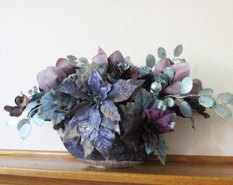 Silk Floral Centerpiece Arrangement with Light Plum Magnolias, Blue Poinsettias, purple orchids, aqua money plant with berries