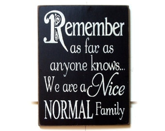Remember as far as anyone knows we're a nice normal family wood sign