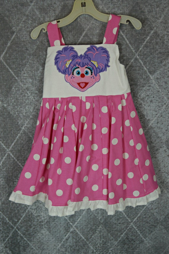 custom boutique twirl dress made with abby cadabby patch 2-6