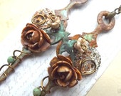 Steampunk earrings, rusty wire wrapped clock hands with gears, flowers and birds