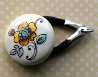 Yellow and Blue Flower Button Clasp - with brown nylon cord loop