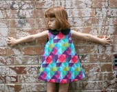 Rainbow Dress with Geometric Fabric and a Peter Pan Collar Size 4