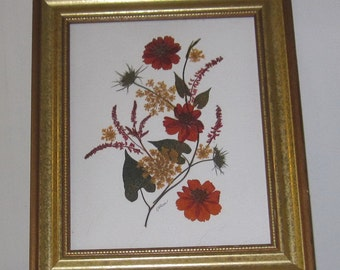 Autumn-tone pressed flowers in 11x13  gold frame