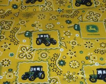 "John Deere Logo Toss on Yellow Camo Cotton Fabric 44"" Wide Sold by the half Yard"