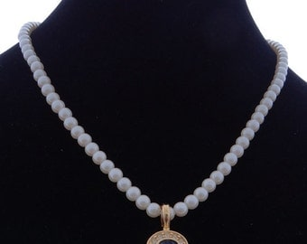 """20% off sale Vintage AVON 18"""" gold tone necklace with white glass pearls & a 1"""" blue and clear sparkly pendant in great condition, appears u"""