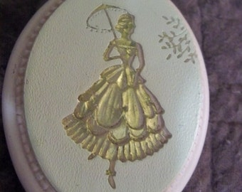 petite engraved lady with umbrella chalkware