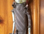 Creepy scary Doll Eyes hanging from face art doll Myopia II