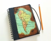 Travel journal with decoupage of South America's map