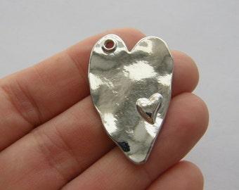 4 Heart pendants silver tone H15