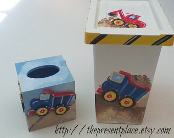 A Two piece boys gift set,with a waste basket and a tissue box hand painted with , a tow truck, earth mover, back hoe and dump truck