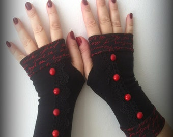 Black   fingerless gloves with red buttons