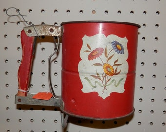 vintage androck red flour sifter with flowers on it triple screen