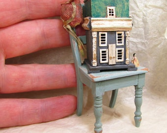 From *DJD* 12th scale tatty chair and French style dolls house,furnished.