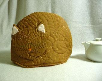 Sleeping brown cat tea cozy, tea cosy