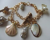 Gorgeous, SHELL, charm bracelet, Natural, cream and gold, by NewellsJewels on etsy