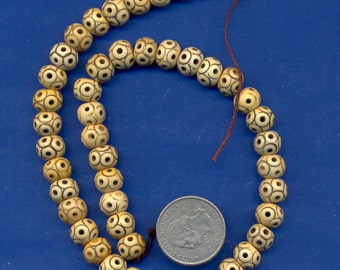 """15"""" strand of 10x7mm tan bone rondell beads with black dot/holes: Lot 31"""