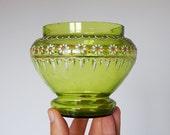 green glass dish with enamel flower pattern