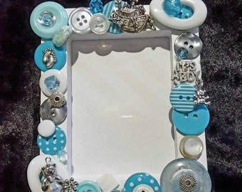 It's a boy beaded picture frame