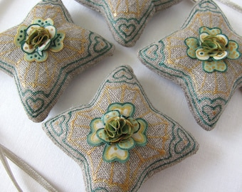 4 hand decorated linen star ornaments - green and gold on natural linen