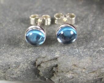 Blue topaz stud earrings sterling silver.