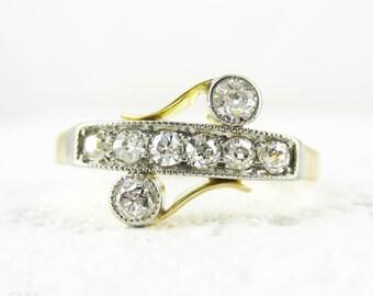 Art Nouveau Diamond Ring, Old European Cut Diamonds in Asymmetrical Design Line & Bezel Setting Milgrain Beading. 18ct Platinum, Circa 1910s