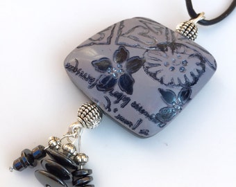 Grey,black and silver textured polymer clay pendant