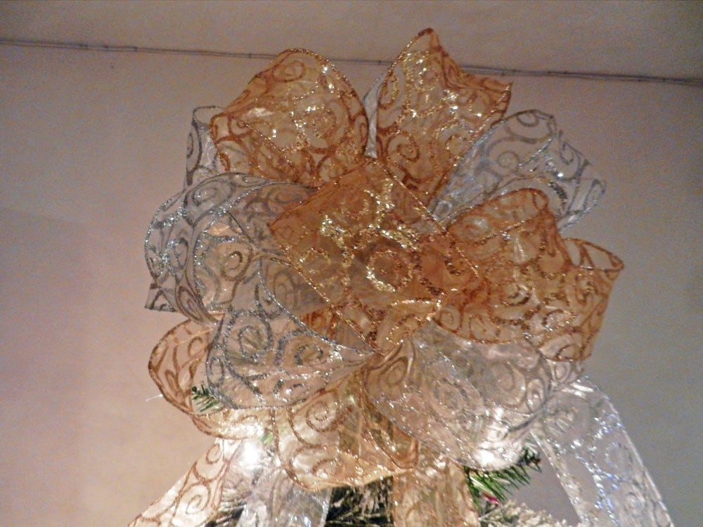 large christmas tree topper bow made with a sheer gold ribbon. Black Bedroom Furniture Sets. Home Design Ideas