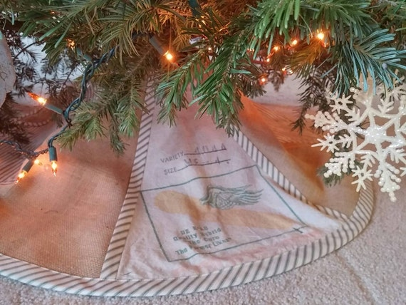 Christmas tree skirt from burlap and vintage feed sack