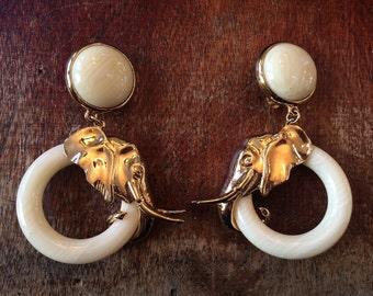 vintage signed carol lee goldtone elephant clip on earrings