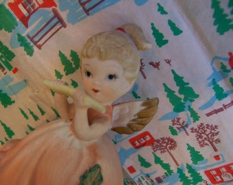 little flute playing angel figurine