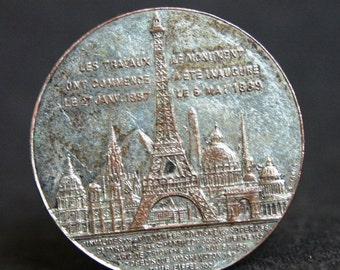 French commemorative souvenir from the Eiffel Tower in Paris. 1889 antique memorabilia silvery medal.