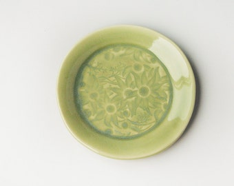 Pale green ceramic plate with Australian Flannel Flowers