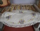 Vintage Dutch Embroidered linen doily. Flower basket leafy vines. Oval table doily. Linen. Floral. Hand sewn.