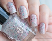 "Nail polish - ""Frail Promise""  pink, aqua, black and white glitter in a light taupe brown base"