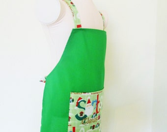 Childrens Christmas Apron - Gorgeous Green Solid Kids Apron with Mint Green Santa is Coming to Town on pocket and Straps