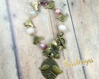 Birds and pearls crystal charm bracelet