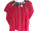 Vintage ceremonial Huipil with hand embroidered feather motifs from Patzún, Guatemala. 1960s. Red with rainbow thread.