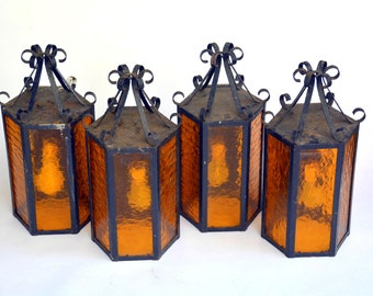Vintage Wrought Iron, Amber Glass Swag Lamp Collection: Set of Four Hanging 6 Sided Mission / Craftsman Lights - Ornate Metal, Intact Wiring