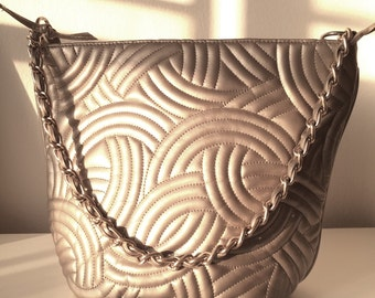 Metallic taupe bucket bag with quilted  detail