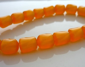Vintage tangerine lucite moonglow twisted barrel beads 7mm