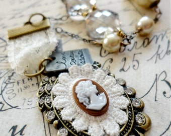 Romantic vintage styled cameo necklace with lace, pearl, sparkling glass bead, and inspirational metal word tag, Drifting Off