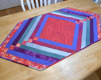 Bright quilted table runner in red, blue, green, purple