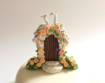 Peacock wedding cake topper with peach roses handmade from polymer clay