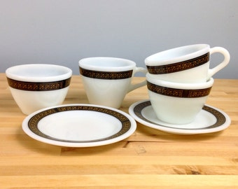 Vintage fleur-de-lis Pyrex by Corning teacups/mugs with two small dessert plates and two custard cups.