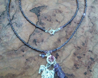 Beaded necklace with silver horse