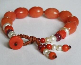 Orange Jade gemstone bracelet with Coral - Ruby - Freshwater Pearl - macrame - Tassel - Tribal - beaded bracelet - Orange stone bracelet